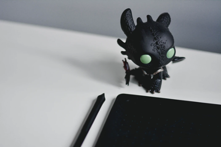 Black plastic anime character standing on a table